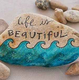 Life is beautiful painted rock